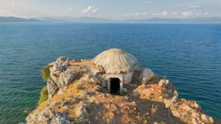 A bunker on a cliff next to the sea in Albania