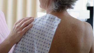 Woman undergoing mammogram