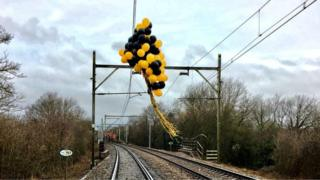 Balloons wrapped around overhead electric lines