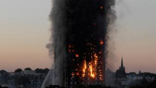 As dawn breaks over west London, the fire continued to rage.