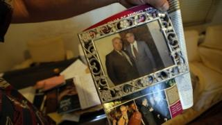 Nizar Temer (l) holds a picture taken with his cousin Michel Temer