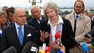 Theresa May and French Interior Minister Bernard Cazenueve