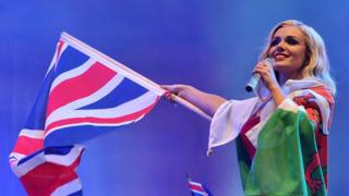 Soprano Katherine Jenkins sings at the Proms wearing Union Jack flag