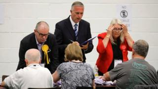 Party activists observe ballots being tallied at a counting centre for Britain's general election in Hastings, 8 June 2017.