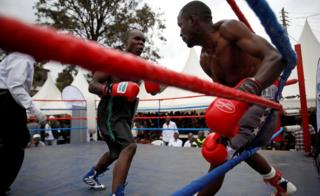 Boxers fight during an east African boxing tournament in the Kibera slum in Nairobi, Kenya, July 29, 2018.