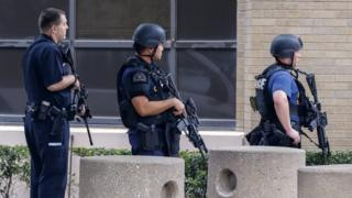 Armed police officers at Dallas police's main headquarters. Photo: 9 July 2016