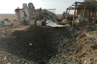 A hole left after an air strike at the headquarters of the Kataib Hezbollah militia group in Qaim, Iraq, on 30 December 2019