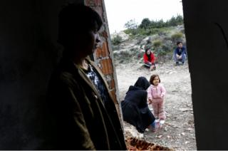 Afghan refugees wait before travelling to the Greek island of Chios, in Cesme district, Izmir, Turkey, 6 March 2016.