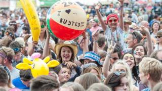Festival goers watch Busted on the main stage