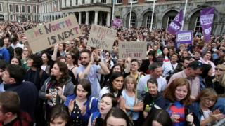Pro-choice campaigners hold up signs calling for the liberalisation of abortion laws in Northern Ireland