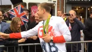 Adam Peaty shook hands with well wishers