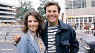 American actor Robert Wagner and his actress wife Natalie Wood at Heathrow Airport in London, 1976.