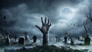 Рука, торчащая из могилы