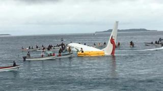 locals approaching to rescue passengers of the crashed Air Niugini aircraft on the remote Island of Weno