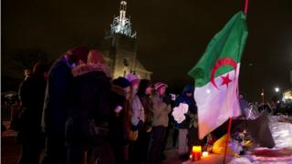 people pay respects at a make-shift memorial following a vigil held in honour of the victims of a shooting in a Quebec mosque in Quebec City, Quebec January 30, 2017.
