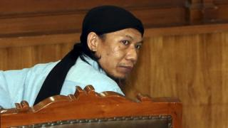 Indonesian terrorist suspect Aman Abdurrahman, alias Oman Rohman, looks on during his trial in Jakarta, Indonesia, 22 June 2018