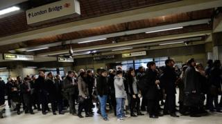 Commuters queue at London Bridge during previous Tube strike