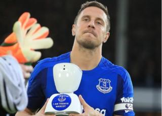 Phil Jagielka and the robot mascot