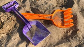 A spade and fork on Great Yarmouth beach