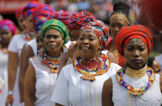 Praise singers in traditional regalia dressed up for mass church service in Johannesburg, South Africa. EPA/Photo - 14 April 2017