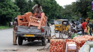 Burundians load belongings on a truck in Bujumbura