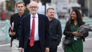 Jeremy Corbyn with aides including Andrew Fisher