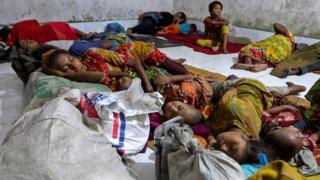 "Bangladeshi villagers sleep in a cyclone shelter following an evacuation by authorities in the coastal villages of the Cox""s Bazar district on May 29, 2017 as Cyclone ""Mora"" gradually approaches towards the coastline"
