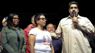 Venezuela's President Nicolas Maduro speaks during an event with supporters, next to newly elected mayor of Libertador district Erika Farias (C) and President of Venezuela's National Constituent Assembly Delcy Rodriguez (L), in Caracas on 10 December 2017