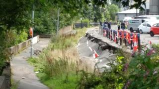 A section of a cycle way along the river has collapsed