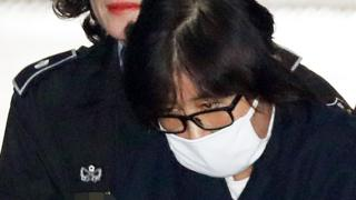 Choi Soon-Sil is escorted into the Seoul Central District Prosecutor's Office in Seoul on 3 November 2016.