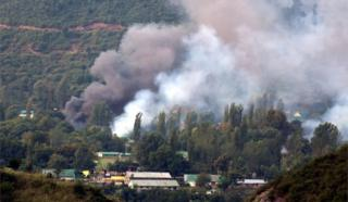 Smoke billows out from inside an Indian Army base which was attacked by suspected militants in Uri, some 115 west of Srinagar, the summer capital of Indian Kashmir, 18 September 2016