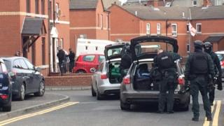 Armed police were seen outside a house in the Frank Street area of east Belfast on Friday
