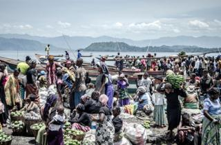 Vendors and shoppers at Kituku market on the shores of Lake Kivu