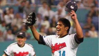 Mexican pitcher Narciso Elvira of the Kintetsu Buffaloes throws his hands in the air to celebrate after he pitched a no-hit, no run game against the Seibu Lions during a Pacific League professional baseball game at the Osaka Dome, in western Japan 20 June 2000