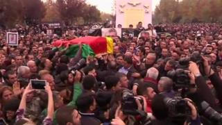 Mr Elci's coffin is carried through massive crowds, draped in the red, yellow and green Kurdish flag