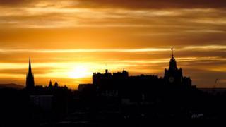 The sun setting behind Edinburgh Castle
