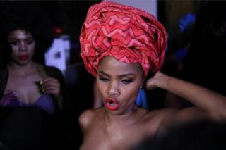 A model waits backstage before participating in AFI Joburg Fashion Week show with the theme #AfroAsia, in Johannesburg, South Africa, in this photo released on 6 October.