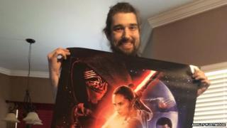 Picture of terminally ill man, Daniel, holding Star Wars poster