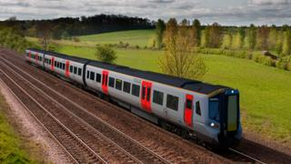 An artist's impression of a black and grey train with red doors travelling through the countryside