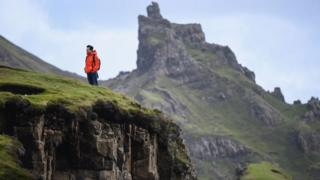 A tourist visiting the Quiraing in 2017