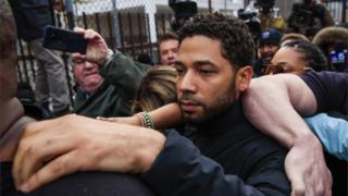 Jussie Smollett emerges from the Cook County Court complex after posting 10 percent of a 100,000 USD bond in Chicago
