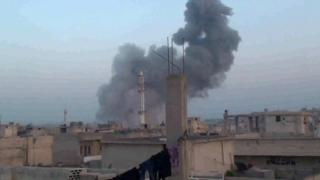 Screengrab of video posted online by activists purportedly showing smoke rising from site of air strike in town of Talbiseh, Homs province, Syria (15 October 2015)
