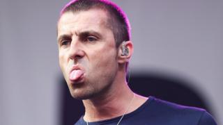 Liam Gallagher sticking his tongue out