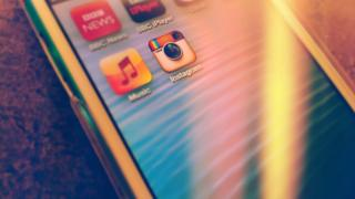 An iPod touch with icons for BBC News, BBC iPlayer and Instagram