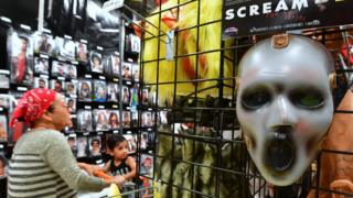 A mask from the TV series 'Scream' is displayed at a store selling Halloween merchandise in Alhambra, California