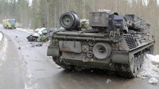 A tank on a road following a collision with a car, in Snasa, Norway (07 March 2016)