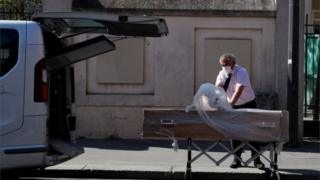 An employee delivers a coffin at the Fondation Rothschild retirement home (Ehpad) in Paris where 16 residents have died and 81 have been infected with coronavirus disease (COVID-19) as the spread of the coronavirus disease (COVID-19) continues in France, March 25, 2020