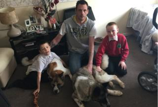 From left to right: son Christopher Marsden, aged 9, Nikki the Akita, Robert Marsden, Diachi the Akita and son Duncan Marsdn, aged 7
