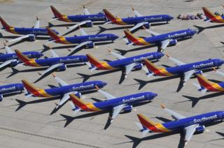 Southwest Airlines Boeing 737 Max aircraft are parked on the tarmac at the Southern California Logistics Airport in Victorville, California