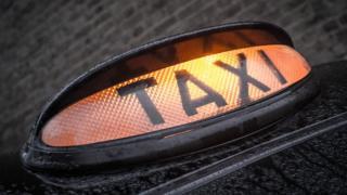 A lit taxi light